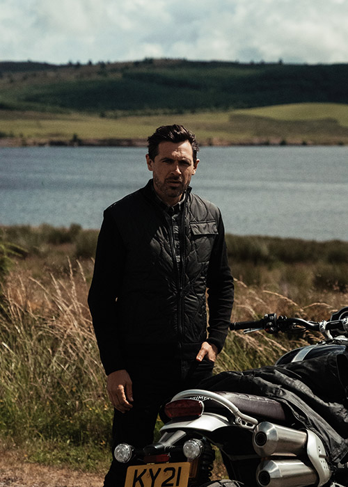 Sam Barham wears the Barbour International AW21 Tourer Collection