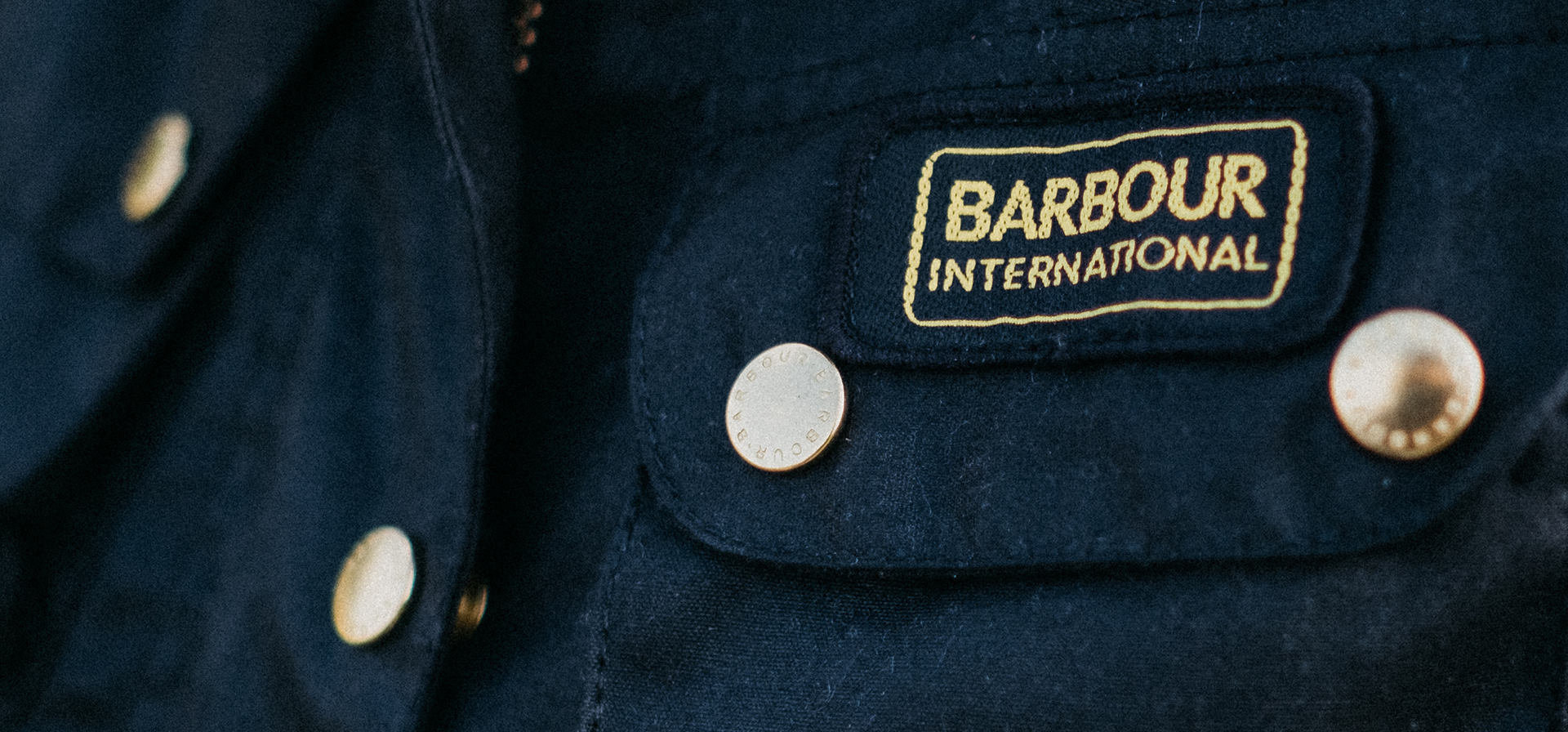 (Barbour) Barbour International Logo lozenge on a waxed jacket