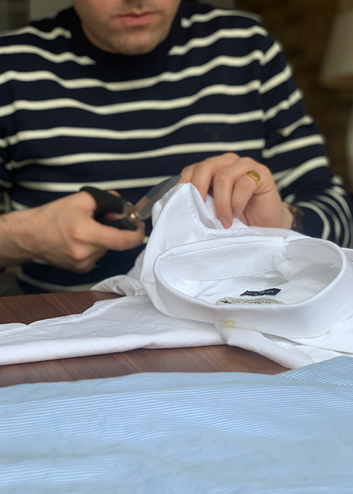 Daniel W. Fletcher wears the Barbour Bight Striped Sweater in Navy while he cuts and sews his new Barbour Shirtusing the Barbour Oxford 3 TailoredShirt in White and the Barbour Oxford 8 Tailored Shirt in Blue