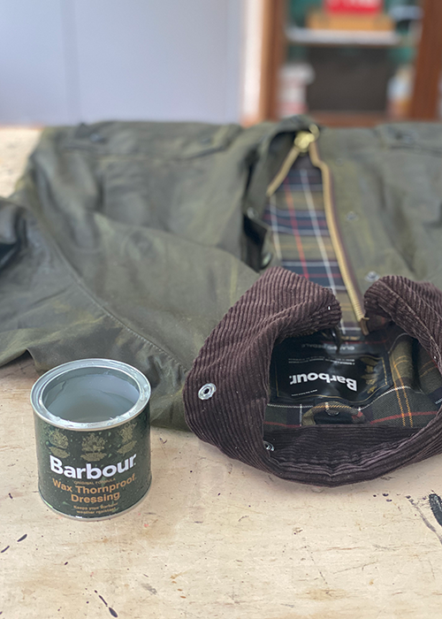 Barbour jacket next to softened thornproof dressing wax