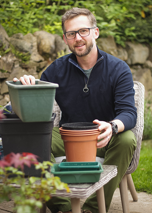 Richard Chivers choosing pots to home grow veg