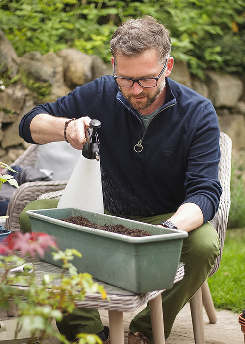 Richard Chivers watering his seeds