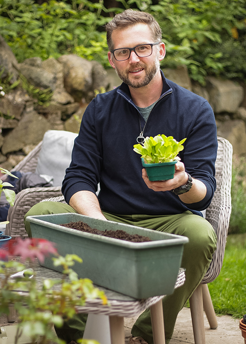 Richard Chivers holding home grown salad leaves