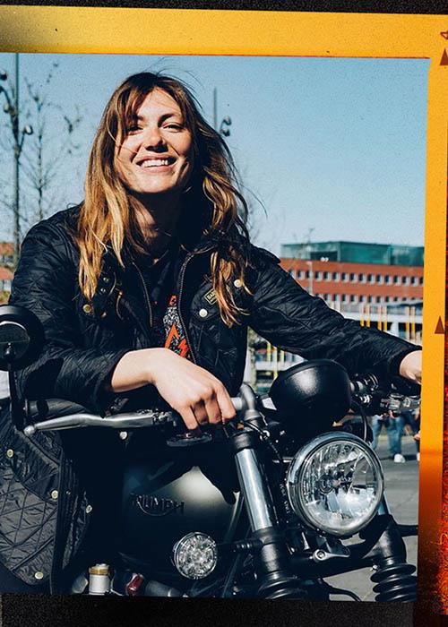 woman wears Barbour International on a motorbike