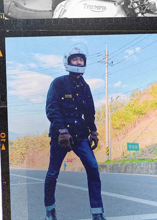 Man wears Barbour International Jacket and motorcycle helmet