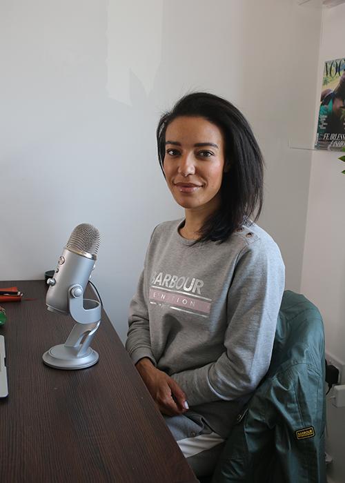 Cyran Bampton recording her podcast