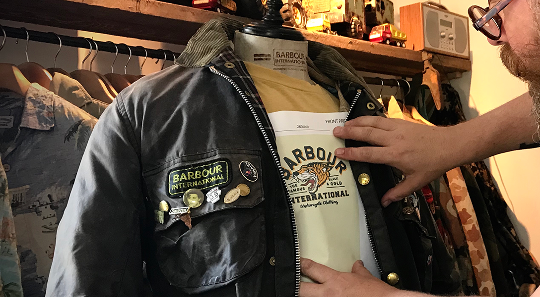 Nige Vallis holding up his design to a Barbour International jacket