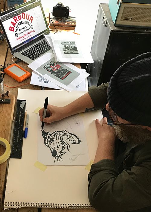 Nige Vallis inking in his sketch for Barbour International