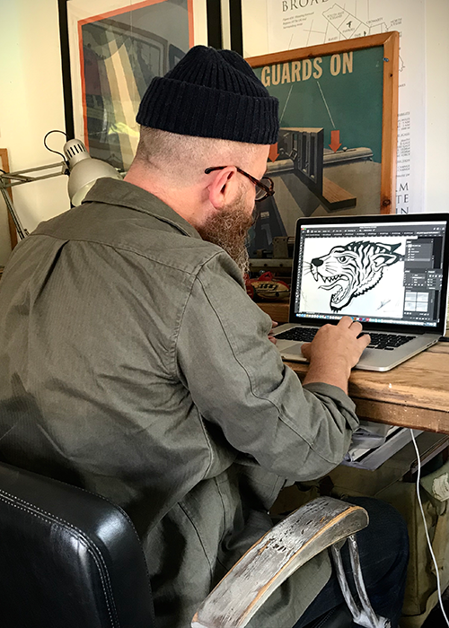 Nige Vallis working on his designs on the computer for Barbour International